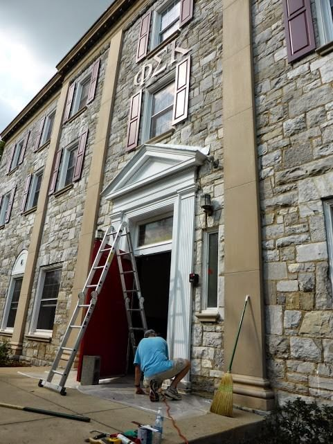 Bruce Balmat '70 gives the front door a facelift.