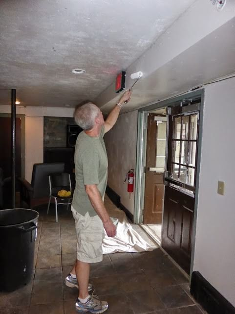 Bob Romeiser '81 gets painting duty in the bar room.