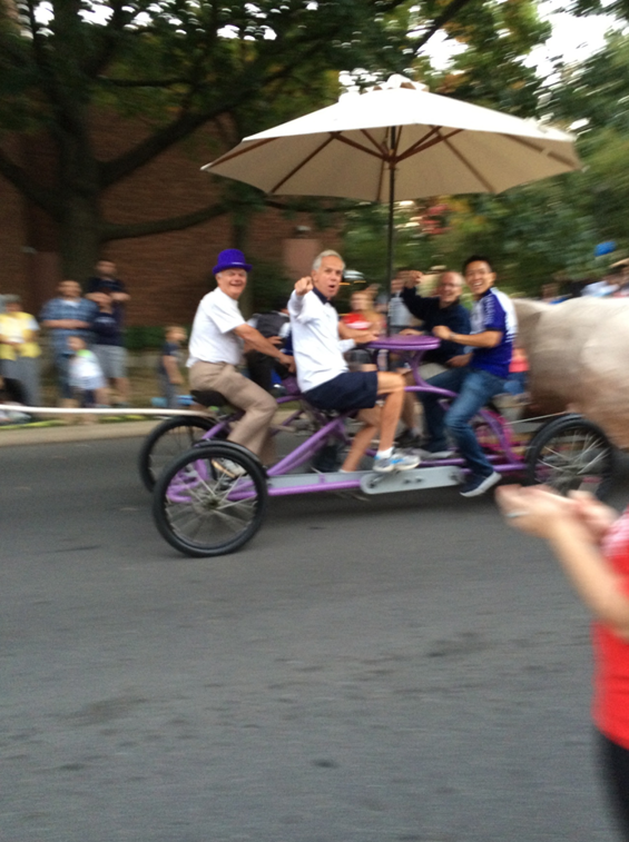 MTM and Bruce on a 5-man bicycle in the 2014 Homecoming Parade